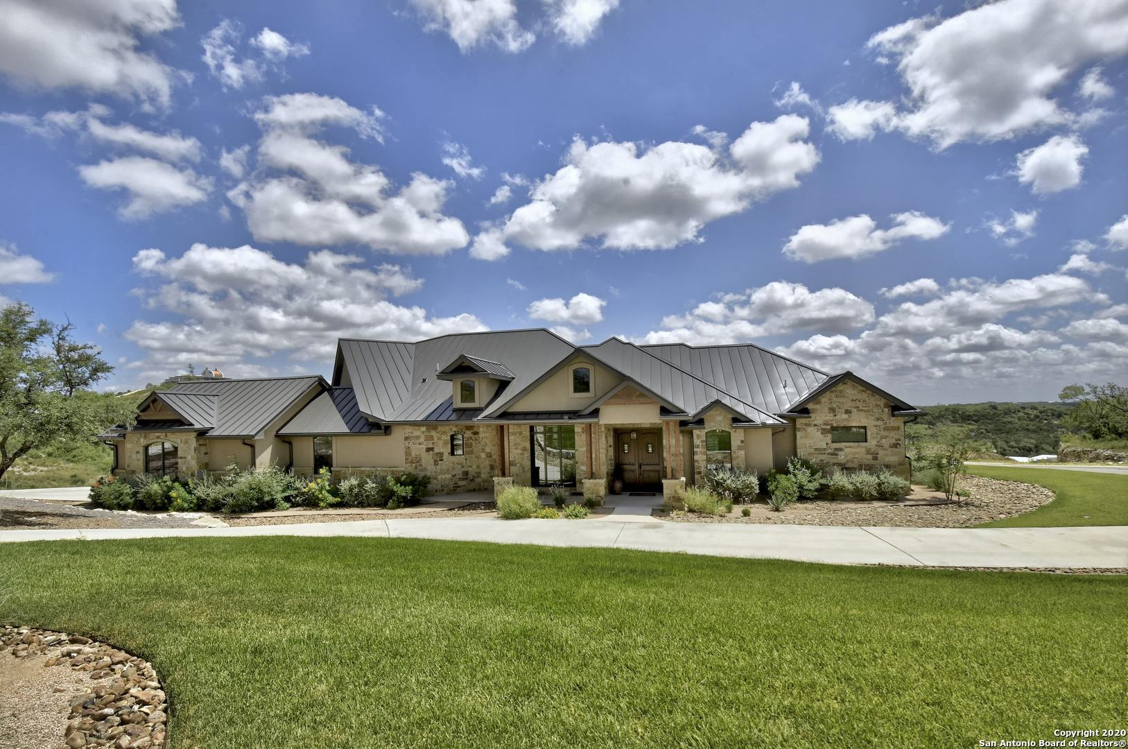 Views! Views! Views! Gorgeous Hill Country, lodge style, retreat on a corner lot offers much serenity just minutes from city amenities. Enjoy unobstructed sunrise views for miles from the spacious covered patio/deck. True one-story living at its finest in a home loaded w/custom stone & warm wood accents. The open floor plan includes both formal dining & eat-in kitchen, executive study, butler's pantry & bonus room for entertaining. The furniture is negotiable and a second lot is available for added privacy! Check out the virtual tour:  https://youtu.be/a_UtgscfpiQ