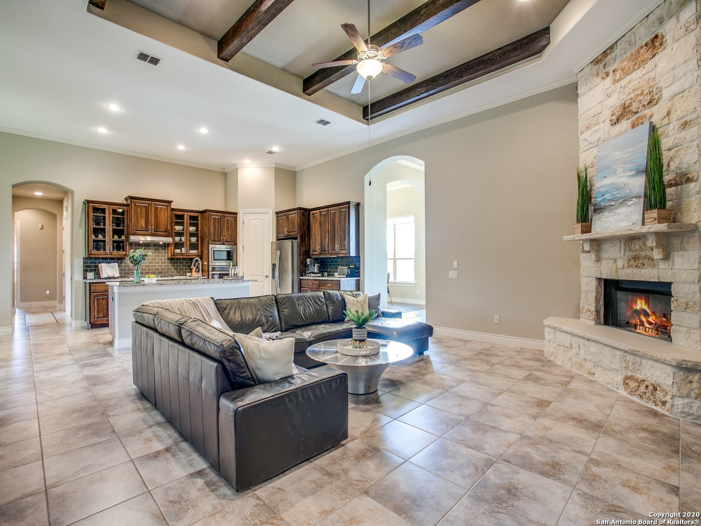 Exceptional property in the highly coveted Canyons at Scenic Loop! Impeccable 1 story home, purchased new in 2017. Add'l approx. 370 sq.ft. of living space of enclosed patio. Expansive corner lot of .64 acres with views overlooking the serene backyard that is ready for your dream pool. Virtual tour: https://my.matterport.com/show/?m=R8jFrC8aTgC&mls=1  Impressive curb appeal with the positioning of the home on the lot & a refined exterior of stone, stucco and metal roof. Enter through the light filled foyer to this elegant property that leads to the formal dining room & a study/office with French doors for privacy. Open plan living at its finest with a gourmet kitchen featuring custom cabinetry, glass tile backsplash, granite counters, & a roomy breakfast space overlooking the exquisite living room with floor to ceiling stone fireplace & impressive beamed ceiling!  A secondary living space media/game room for relaxing days at home. For privacy, the home offers a slit plan layout of the bedrooms. An airy Master with tray ceiling, crown molding & views to the backyard is your tranquil get-away. The master bath is a true statement, with 2 vanities, soaking tub & a huge walk through shower with dual shower heads & bench seat. Upgrades include solid surface flooring throughout, 8 ft. doors, crown molding. enlarged driveway, 3 car oversized/ extended garage. The patio has been completely enclosed & upgraded with a full kitchen including a barbecue plus a gas cook top, stove & A/C for comfort!  Glass sliders to the expansive back yard -your luxurious home awaits in the idyllic Hill Country setting of The Canyons!! Proximity to La Cantera, The Rim!