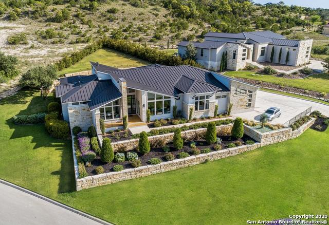 There are not the right words that can convey how specially crafted this home is. You must see it in order to capture the attention to every single planned element. Exquisite detail in every room of this custom 2017 Partners in Building Parade of Homes showcase property. The Canyons at Scenic Loop invites you to this open concept living experience starting with  a grand entry flanked by a study with custom masterly crafted built-ins &  a huge dining room looking onto the lush landscape of the  tiered front yard.  Nearby, a custom built in bar/serving center making this an entertainers dream. The soaring ceilings highlighted by the one of a kind floor to ceiling fireplace provides the focal point of the living room that opens to the chef's kitchen. The natural light  from wall to wall windows showcases the privacy of the back yard created by custom designed landscaping. The kitchen features a massive island with a sleek waterfall and bar stool space. Master crafted cabinetry, commercial gas range, custom island lighting, drop down lighted ceiling, custom designer tile herring bone back splash, are just some of the highlights of this purposely designed space.  The family/game room separates the main living with the guest bedrooms but is not light on design. Step form the family/game room onto the 27x15 covered deck and relax with a view of the tiered green space framed with landscape that has been masterfully created. The guest suite and 2 other guest bedrooms all feature custom design accent walls, custom lighting, and ceiling treatments. The master retreat is a spa experience with a huge walk through double shower, expansive vanities, stand alone soaker tub, master closet w/wall to wall custom built-ins and a zen vibe you will not want to leave. Stats: 4 BR, 3.5 BA, 3 Car Garage, Huge Laundry Room, Mud Room, all sitting on .56 AC. This home is built for function but designed for the the most discerning buyer. Go to this link to view the Parade of Homes photos: ://ww