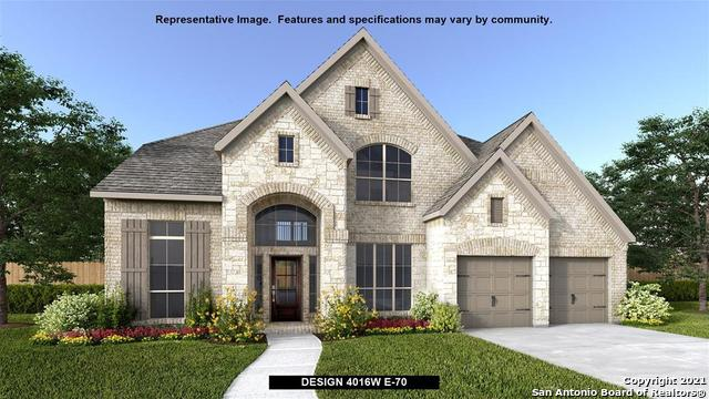 PERRY HOMES NEW CONSTRUCTION! Elegant two-story design featuring a 20-foot rotunda ceiling. Home off
