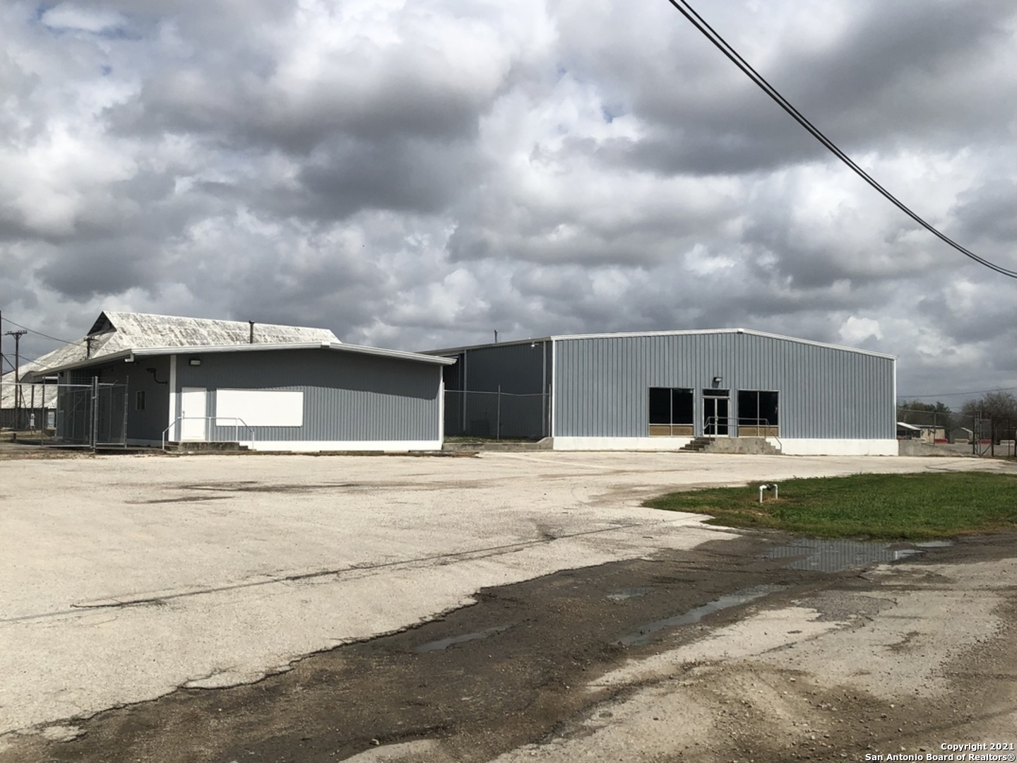 10+ acres within the city limits of Kenedy. Land is totally encompassed by security fencing and much of the acreage is already paved. Large office building, warehouses, loading docks, storage buildings and plenty of parking. City utilities. Easy access to State Hwy 72. This facility used to be known as the Kenedy Farmers Co-Operative years ago, great location with plenty of room to expand if needed within the fencing. Current owners have done many imporvements