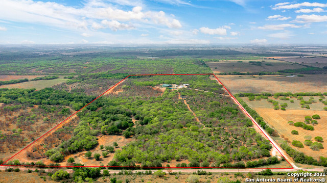 This 68 acre game-fenced bow ranch is located less than five miles southeast of Kenedy, Texas. The property is less than an hour from San Antonio and Corpus Christi and about three hours from Houston, making this the perfect recreational or corporate getaway for any occasion. Electric gated entrance leads from paved County Road 136 to the private and secluded headquarters. The main home is a 3,000 square-foot ranch house with five large bedrooms, two full bathrooms, and one-half bath. The home features an expansive open gathering area with oversized kitchen and gorgeous fireplace. Additionally, there is a 1,488 square-foot two-bedroom guest or foreman's house and a 1,200 square-foot barn and implement shed. Next to the main home and headquarters area is a 3/4 acre pond stocked with catfish. Also, several blinds protein and corn feeders have been strategically placed across the property to provide for excellent bow hunting. The ranch is stocked with exotics including Blackbuck, Red Stag, Axis, Zebra, and Elk; all of which will convey with the sale of the property. One electric well supplies water to all of the improvements at the headquarters and two septic tanks on the property. This is an excellent starter bow ranch with an array of exotic wildlife, which is rare and somewhat of a novelty in this area of Texas. Schedule your showing today!!
