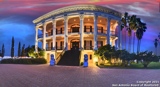 The historic 'Southwind Ranch' is a one-of-a-kind Texas landmark. Founded as a registered beef cattle operation, the current ownership transformed the estate into a scenic retreat for the church.  The main house, alone, is over sixteen thousand square feet on multiple levels with a total of 34 rooms. An architectural masterpiece, this classic antebellum also boasts a 4-car garage, pool, sauna, tennis courts, dog kennels, and well-appointed outdoor entertaining area.    The improved pastures and facilities are currently being utilized for a distinguished equestrian breeding operation. Water is abundant. A combination of, well and municipal water, supplies the structures and troughs. The sizable lake is regulated and replenished by an adjoining well. The lake is fittingly stocked with several species of fish and provides an excellent waterfowl habitat.    An intricate network of holding pens and alleyways leads to a converted auction ring within the estate. The horse barn encompasses a half dozen stalls with ample storage.   Nearby rustic bunkhouse provides another living quarters. The Ranch Foreman Compound includes a comfortable 3 bedroom 2 bath home with attached office near the front of the estate. Lastly the cozy fisherman's cottage can be found on the shores of the stock lake.    Less than an hour from San Antonio International Airport, The SouthWind Ranch is located on US Highway 181 between Karnes City and Kenedy, Texas. Call Trevor Morton today at (210) 725-1685 to view this spectacular slice of South Texas.