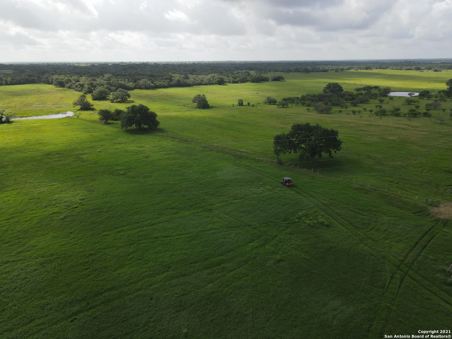 """A 102 acre sportsman & rancher's paradise! This property has CD 90160 Hybrid Bermuda grass - a hybrid grass developed by Texas A&M as a specialty grazing, baling, and pasture grass. You will NOT find another property better maintained, fertilized, brush controlled, & weed controlled. This amazing acreage has beautiful HUGE oaks and pecans throughout. There is an amazing pond - perfect for fishing, wildlife & livestock. There is an abundance of deer, wild turkey & other beautiful wildlife. There is a new (2020) metal building with 50x50 insulated shop area equipped with three 14x14 electric sectional rollup doors. Attached is additional roof area making the building 11,250 sqft of under roof space!  This property has a 2 bedroom, 1.5 bath older home with a great covered carport & covered porch area - perfect for weekends! There is a great separate 20x42 metal building, which is a perfect """"man cave"""" or deer processing room!   This dream acreage has it ALL - one you CANNOT pass up!!"""