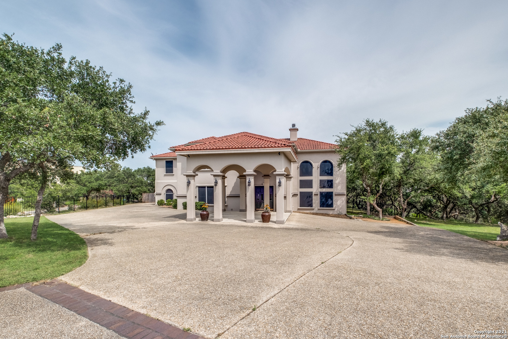 Welcome home to your private 2 ACRE hilltop retreat with gated entry... WOW!  As you approach this G