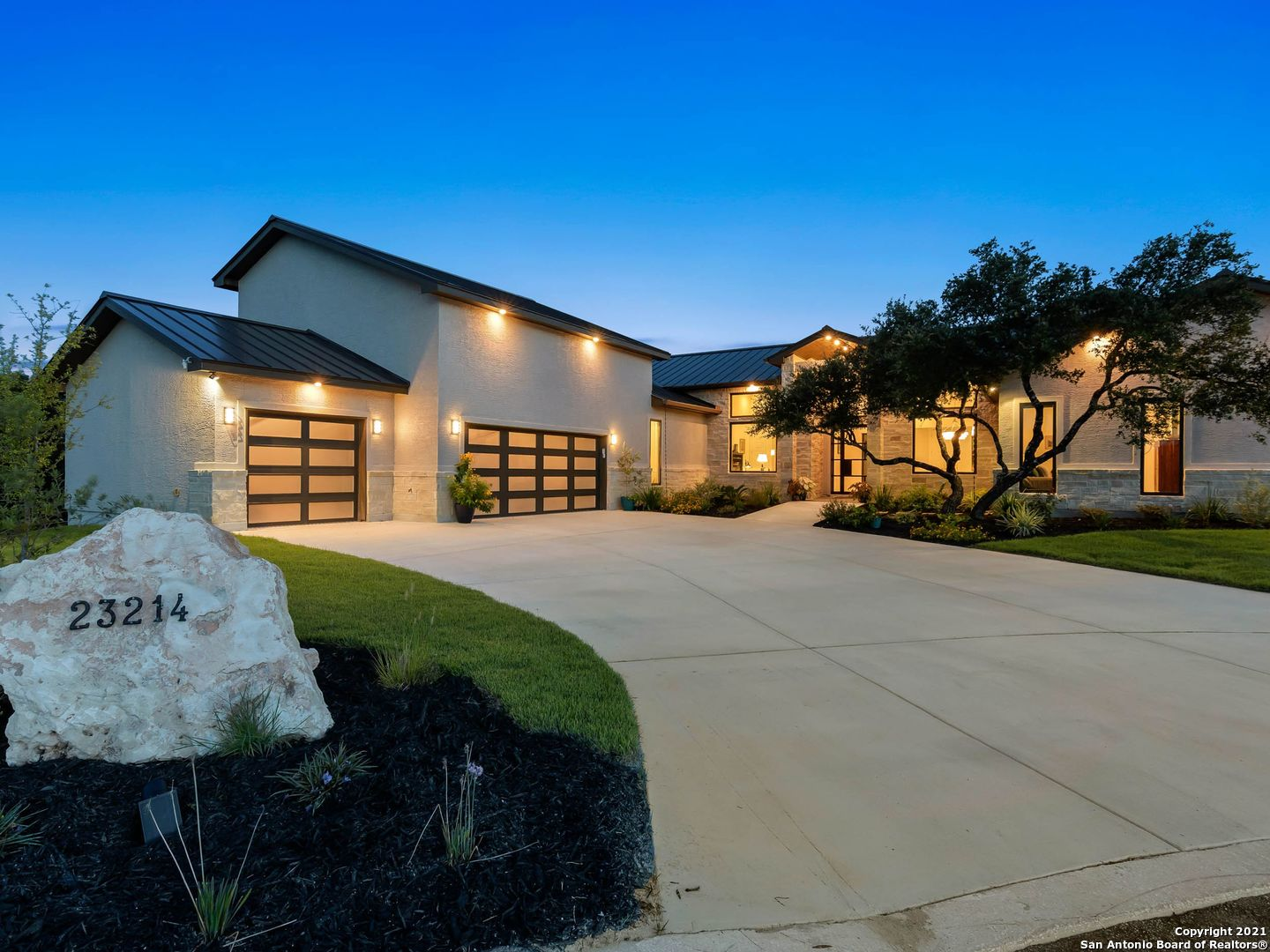 Built in 2020, this almost new home is nestled on a private lot in The Canyons at Scenic Loop. This home features a seamless layout for daily living & sophisticated entertaining. The open floor plan was thoughtfully designed with clean lines & greenbelt views from almost every room.  A light filled great room is complete with high ceilings, back-lit built-ins, gas fireplace & easy access to an extensive outdoor living space with fireplace & outdoor kitchen. Gourmet kitchen with a waterfall island is sure to be a gathering space when entertaining family & friends. This mostly one-story floor plan offers a fourth bedroom/guest suite with a full bath upstairs that can also be used as a game room or studio.  All other bedrooms are downstairs with a split plan for privacy. Master bedroom  has outside access to a private patio & a wall of windows that highlight the views.  Spa inspired master bath with a private exercise room, large walk-in closet & access to the laundry room. Media room opens to the outside & is adjacent to a full bath (that also has outdoor access) could be an additional downstairs bedroom.   Study at front of home does have a closet & would accommodate a Murphy bed.  Three car garage and much more.  Some additional features to note: outdoor fountains viewed from entryway, multiple covered patios, amazing closet space, wide hallways, versatile floor plan, hidden storage space, extra large pantry and laundry with outdoor access.